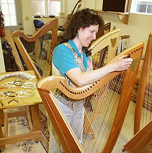 Sharon Thormahlen strings a harp